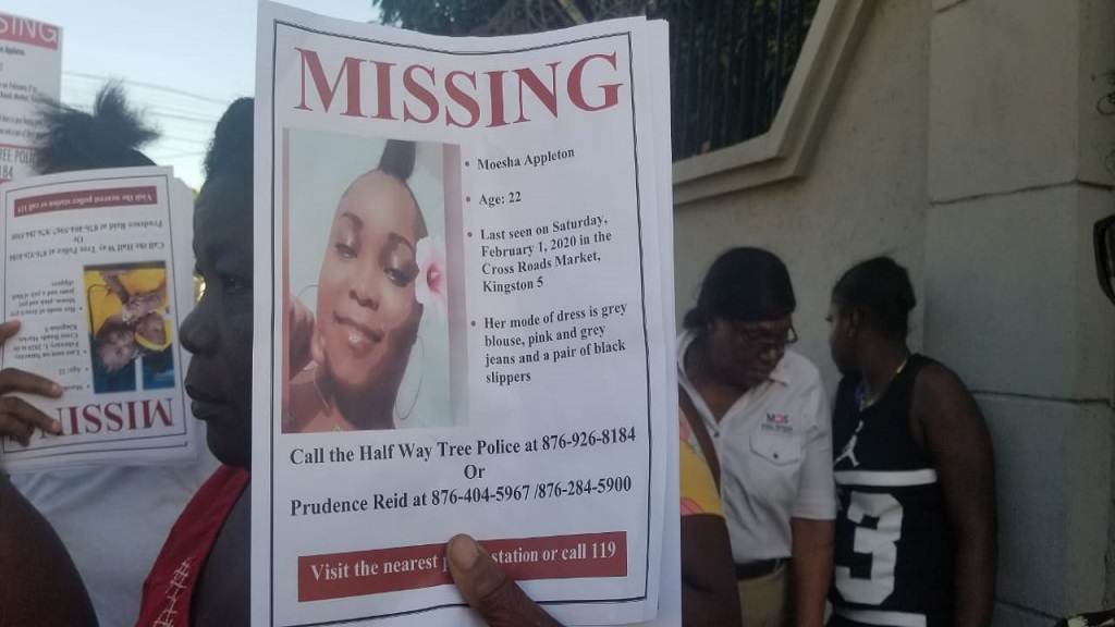 Missing person notifications being displayed by friends and family members of Moesha Appleton of Arnett Gardens, St Andrew, who staged a march in the Corporate Area on Wednesday to bring attention to her disappearance.