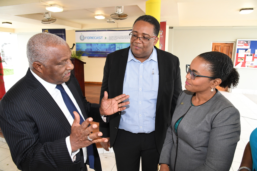 Claudine Allen (right), Executive, Member Relations at The Jamaica National Group and Professor Michael Taylor (centre), Dean, Faculty of Science and Technology at the University of the West Indies, Mona, listen keenly to appoint being made by Dr Glen Christian, Convenor of the Science, Technology, Engineering and Mathematics for Growth Task Force, during the recent launch of the Forecast 2020 Conference.
