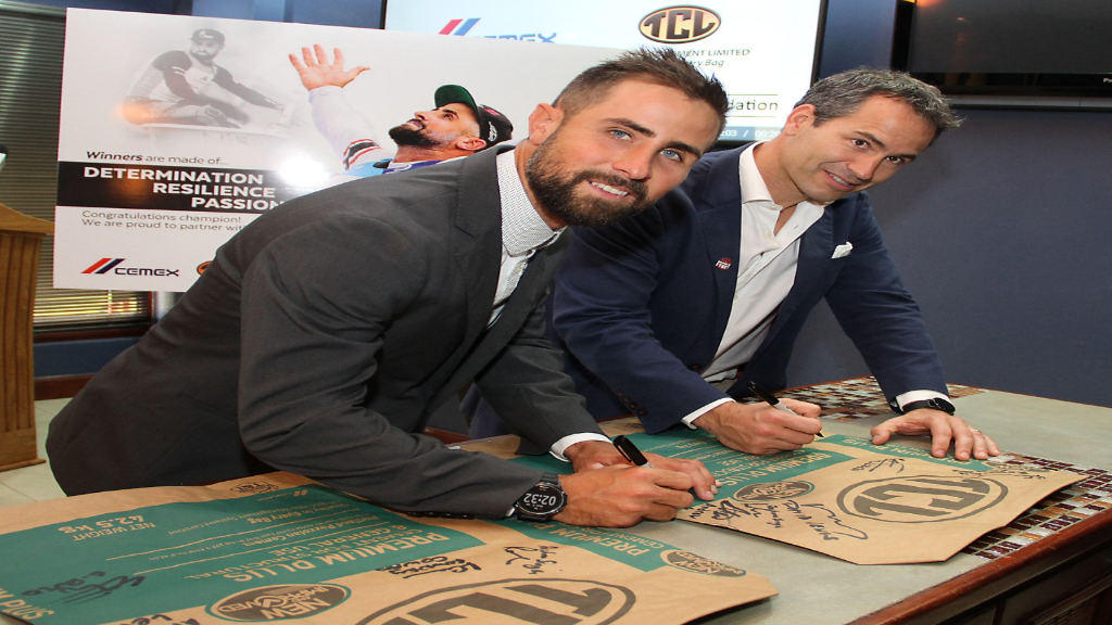 Andrew Lewis and Guillermo Rojo, General Manager,  CEMEX TCL signs commemorative TCL sacks. Photo courtesy CEMEX/TCL.