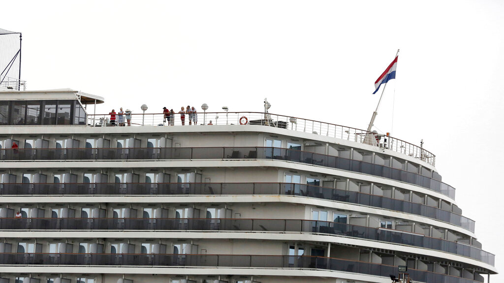 Passengers stand on the top deck of the MS Westerdam while the cruise ship is docked in Sihanoukville, Cambodia Monday, February 17, 2020.  (AP Photo)