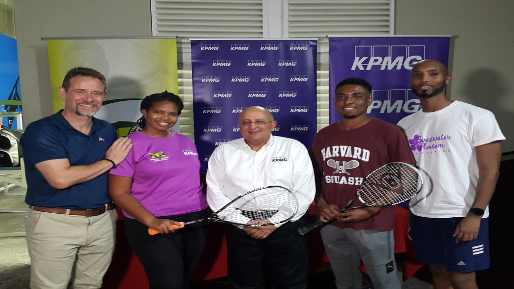 Tarun Handa, (centre) Managing Partner for KPMG in Jamaica poses with players and officials from the Jamaica Squash Association at the recent launch of the 2020 KPMG Squash League  at the Liguanea Club in Kingston.