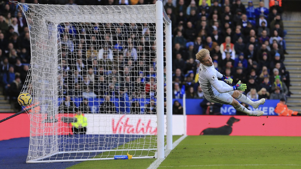 Leicester's goalkeeper Kasper Schmeichel failing to stop the goal scored by Chelsea's Antonio Rudiger during their English Premier League football match at the King Power Stadium, in Leicester, England, Saturday, Feb. 1, 2020. (AP Photo/Leila Coker).