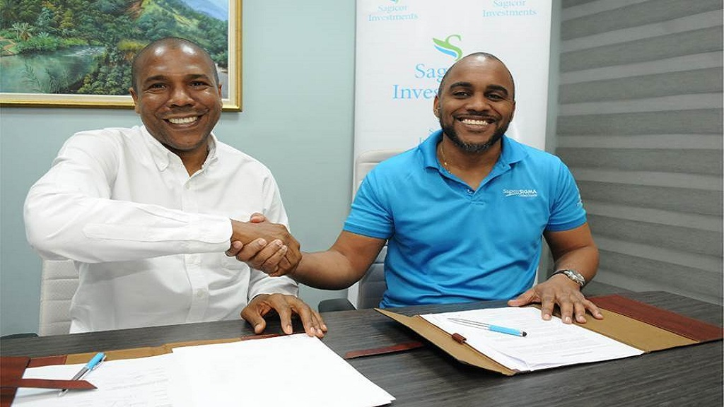 Christopher Williams (L), President and CEO PROVEN Management Limited (PROVEN) and Kevin Donaldson, CEO, Sagicor Investments Limited; used a customary handshake to indicate a signed agreement between the companies to proceed with plans for the upcoming PROVEN Additional Public Offer (APO).