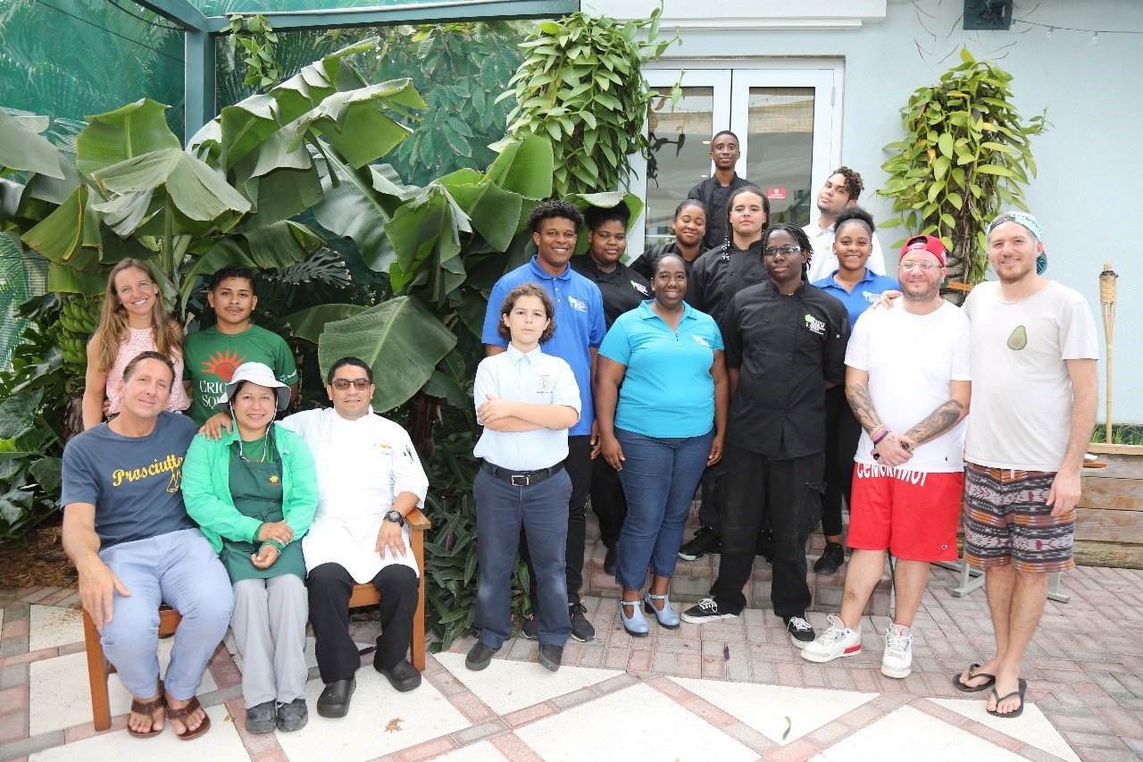 Front left; Dean Max, Consulting Chef - Brasserie, Aide Lopez, Head Gardener, Artemio Lopez, Chef de Cuisine, standing behind, Louise FitzRoy, Marketing & PR - Brasserie, Efrain Alarcon Head Bee Keeper, Tanique Dunbar, (Light blue shirt) Senior Lecturer, SHS. On the right - Chef Mike, Sous Chef & Spike Mendelsohn with the SHS students.