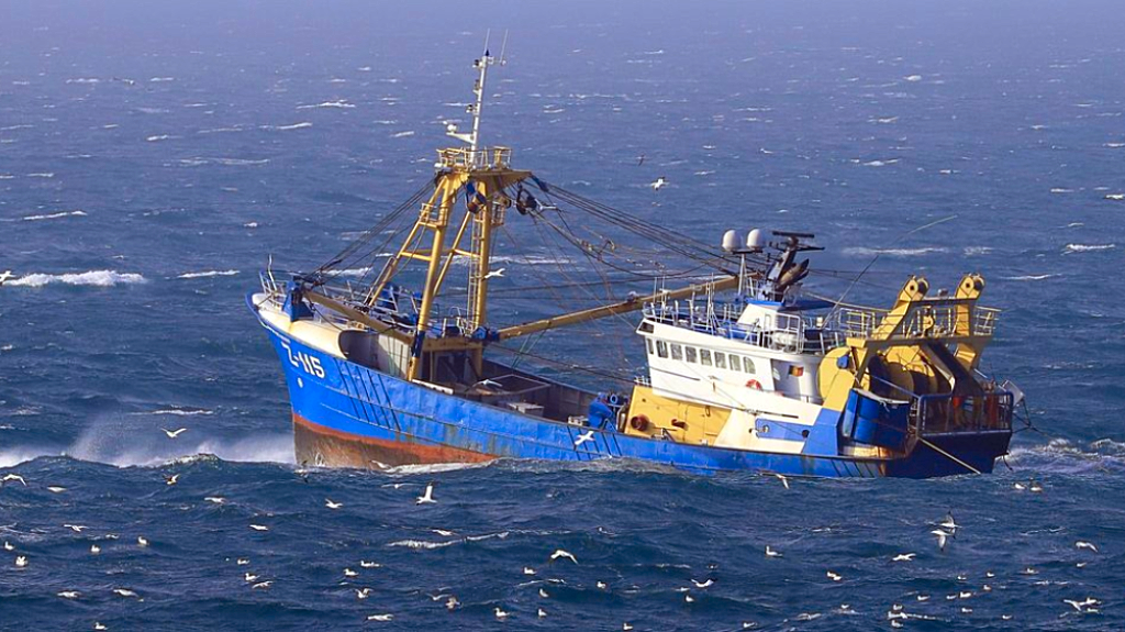 A fishing boat at work in the English Channel, off the southern coast of England, Saturday Feb. 1, 2020. The fishing industry is one of the main subjects for negotiations, after the UK left the European Union on Friday, ending 47 years of close and sometimes uncomfortable ties to Brussels. (Gareth Fuller/PA via AP)