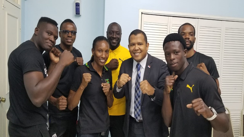 Jamaican boxers share a happy moment with head coach  Gilbert Vaz (fourth left) and Third Secretary at the Panamanian Embassy, Roger Gonxalex Martinex (fifth left) at the launch of the Jamaica vs Panama Gloves Over Guns fight card at the Sports Development Foundation on Thursday, February 20, 2020.