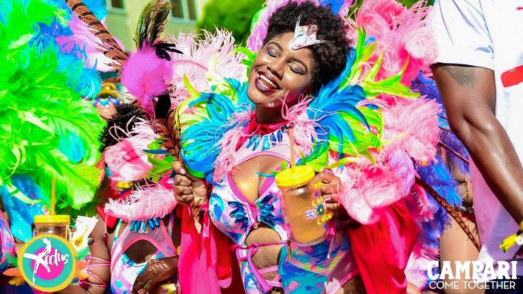 An Xodus masquerader enjoying herself during the Road March last year. Photo courtesy Xodus
