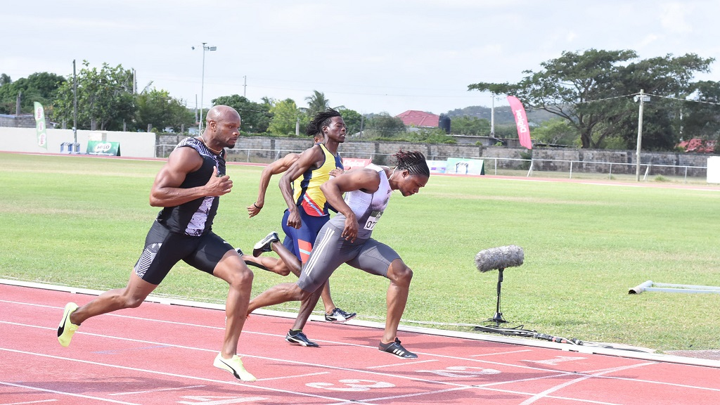 Asafa Powell (left) of MVP Track Club gets the better of Sprintec Lions' Andrew Fisher to win section one of the men's 60m at the 42ndedition of the Milo Western Relays at GC Foster College on Saturday, February 8, 2020. (PHOTOS: Marlon Reid).