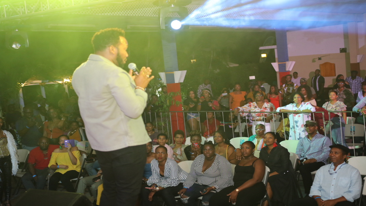 Dancehall artiste Agent Sasco entertains the audience at the Live At Curphey benefit concert at Curphey Place in St Andrew on Friday.