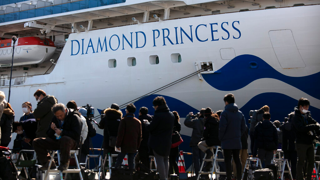 FILE - In this February 11, 2020, file photo, media gather outside the quarantined Diamond Princess cruise ship in Yokohama, near Tokyo. (AP Photo/Jae C. Hong, File)