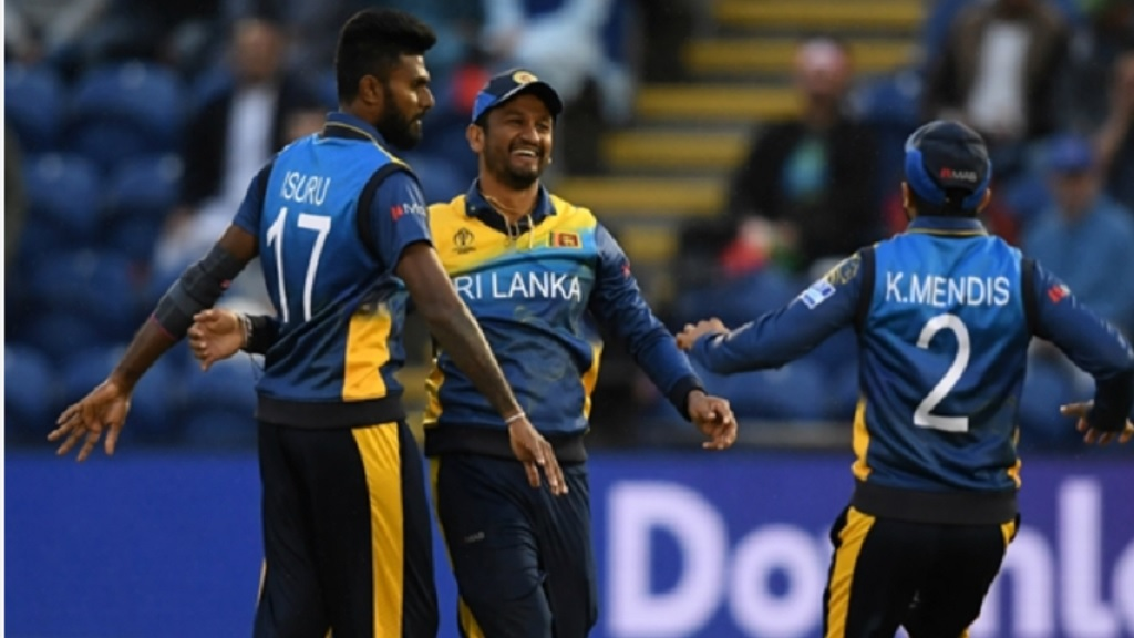 Dimuth Karunaratne (centre) celebrates with teammates at the Cricket World Cup.
