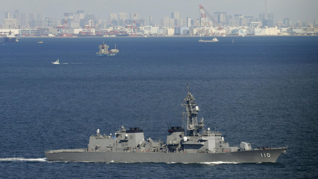 Japan Maritime Self-Defense Force's destroyer Takanami leaves for the Middle East off Yokosuka, south of Tokyo, Sunday, Feb. 2, 2020. The Japanese warship departed Sunday for the Middle East to ensure the safety of the country's oil tankers in waters where tensions between the U.S. and Iran are high. (Meika Fujio/Kyodo News via AP)