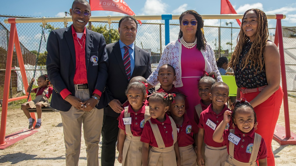 Photo: Children pose with Paul Mongolas Councillor for the Sangre Grande North East (from left) Anil Juteram, Chairman of the Sangre Grande Regional Corporation, MP for Toco/Sangre Grande Glenda Jennings-Smith and Penny Gomez CEO Digicel Foundation at the launch of the Play Park at the Marlay Oval, Sangre Grande. Photo courtesy the Digicel Foundation.