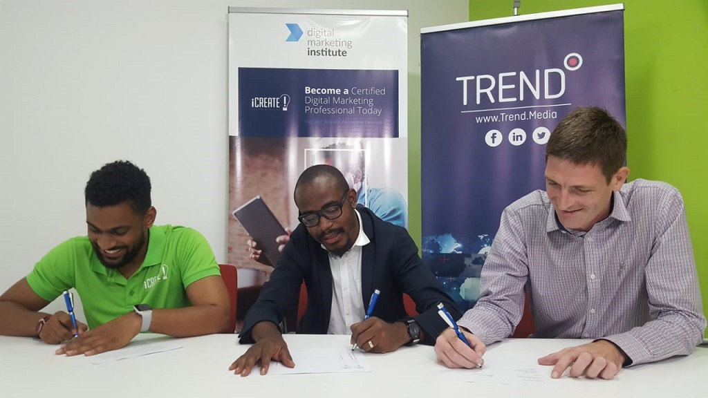 (From left) iCreate General Manager Carl Carram and CEO Tyrone Wilson with Declan Tully, Group Head of Revenue for Trend Media, at a signing ceremony last year for the entities' digital partnership.
