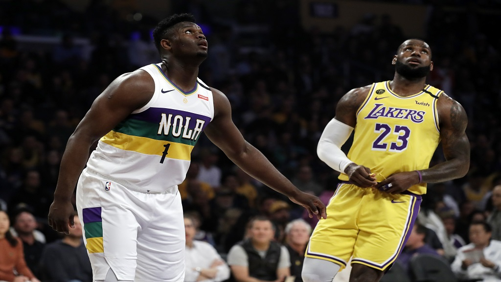New Orleans Pelicans' Zion Williamson (1) looks on from under the basket during free throws next to Los Angeles Lakers' LeBron James (23) during the first half of an NBA basketball game Tuesday, Feb. 25, 2020, in Los Angeles. (AP Photo/Marcio Jose Sanchez).