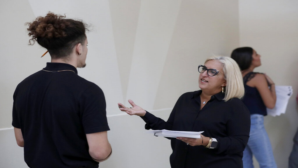 In this October 1, 2019, file photo, Gory Rodriguez, of Starbucks, right, interviews a job applicant during a job fair at Dolphin Mall in Miami. (AP Photo)