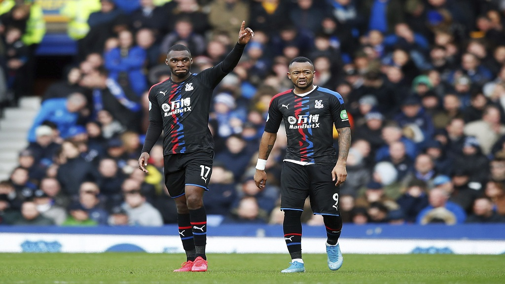 Crystal Palace's Christian Benteke, left, celebrates scoring his side's first goal of the game against Everton, with Jordan Ayew during their English Premier League football match at Goodison Park in Liverpool, England, Saturday Feb. 8, 2020. (Martin Rickett/PA via AP).