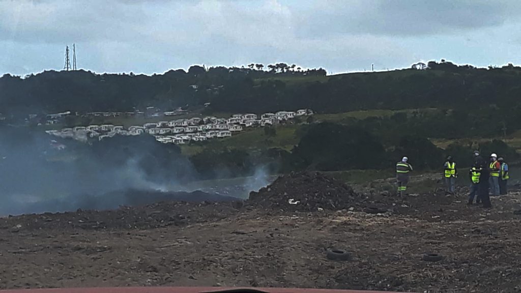 Less smoke over the Mangrove landfill area on day three.