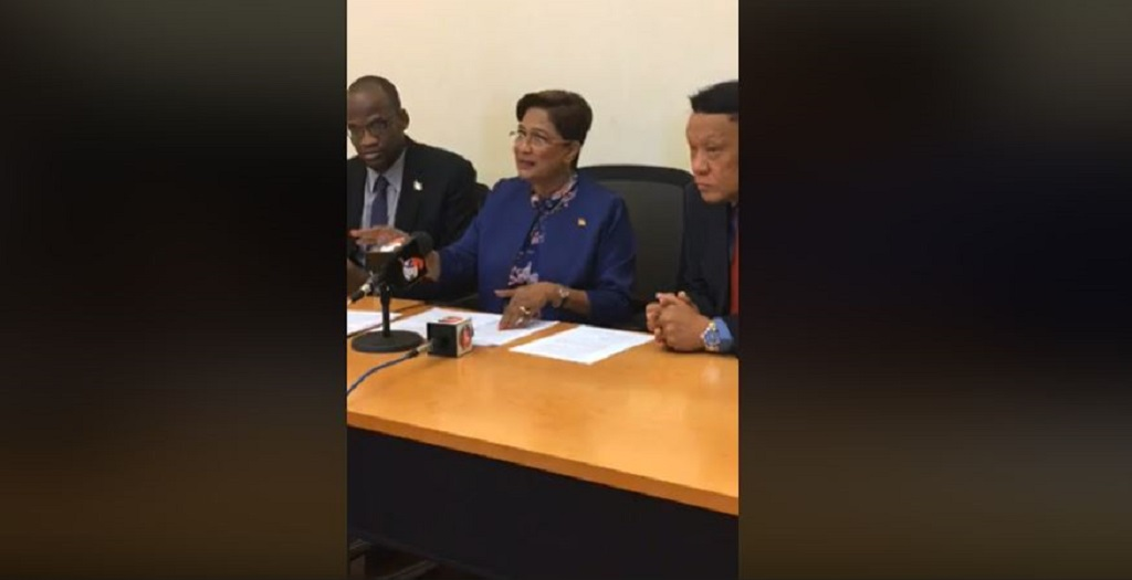 From left to right: Opposition Senator Taharqa Obika; Opposition Leader Kamla Persad Bissessar; Point-a-Pierre MP David Lee.