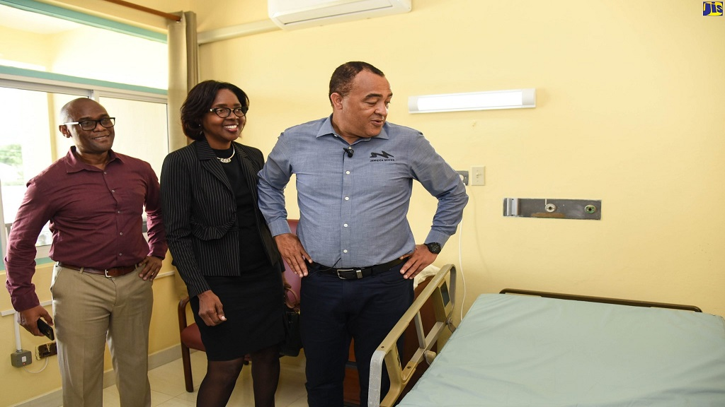 Minister of Health and Wellness, Dr Christopher Tufton (right), inspects one of the quarantine rooms at St. Joseph's Hospital in St Andrew, with the Chief Executive Officer at the hospital, Leon Dixon; and Director of Health Services, Planning and Integration in the ministry, Dr. Naydene Williams, during a tour of the facility on Tuesday, February 18.
