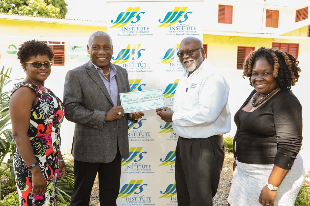 Orville Johnson (2nd right) Chairman of Best Care Foundation receiving the donation of $150,000 from Chairman of the Jamaica Institute of Financial Services (JIFS) Dr Rickert Allen while Executive Director of JIFS Darlene Jones (left), Principal, Shariffa Brock-Lewin (right) look on.