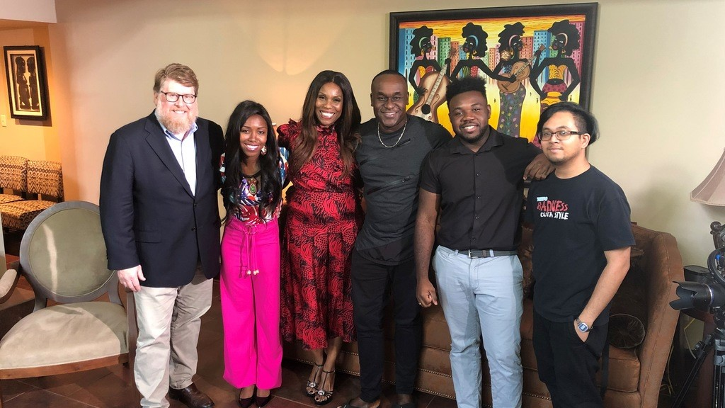 Celebrity publicist Yvette Noel-Schure pictured in centre with the TEMPO production after an Caribbean Dream episode filmed at her home in New York.