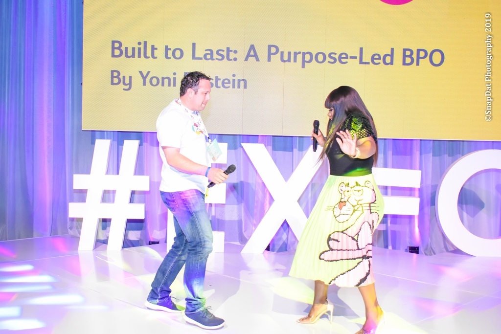 itelpbo CEO Yoni Epstein and Miss Kitty at a recent company seminar.