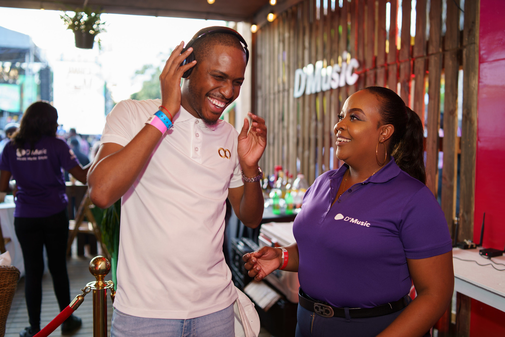 Valon Thorpe, CEO of Mystique Integrated Services, entered a musical world of his own when Tamesha Kelly, D'Music representative, handed him a pair of wireless headphones to listen to the latest tracks from the 2020 Jamaica Rum Festival playlist in the Digicel D'Music Experience booth.