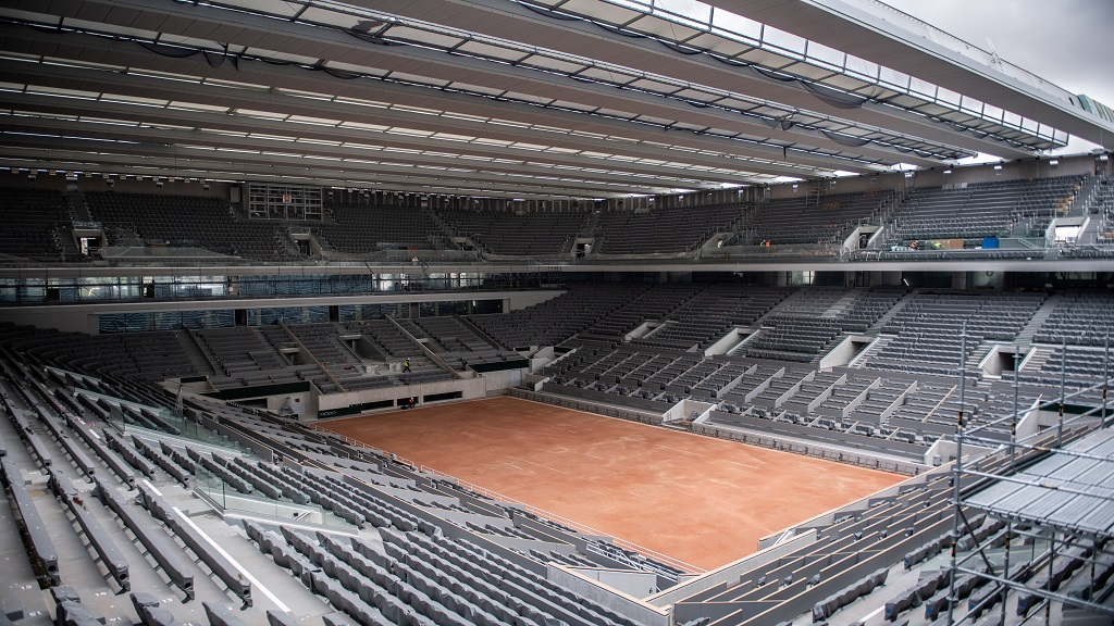 In this Feb. 5, 2020, file photo, construction work of the newly built roof of the Philippe Chatrier center court is pictured at Roland Garros stadium in Paris. The French Open has been postponed because of the coronavirus. (Martin Bureau/Pool via AP, File).