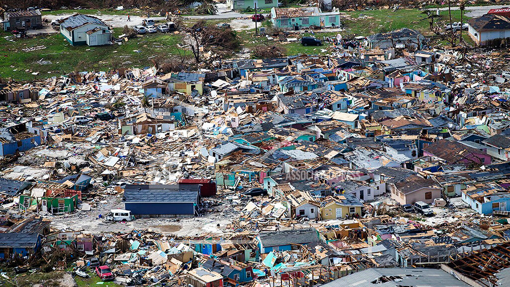 This photo shows destruction from Hurricane Dorian at Marsh Harbour in Great Abaco Island, the Bahamas, Wednesday, Sept. 4, 2019. (Al Diaz/Miami Herald via AP)