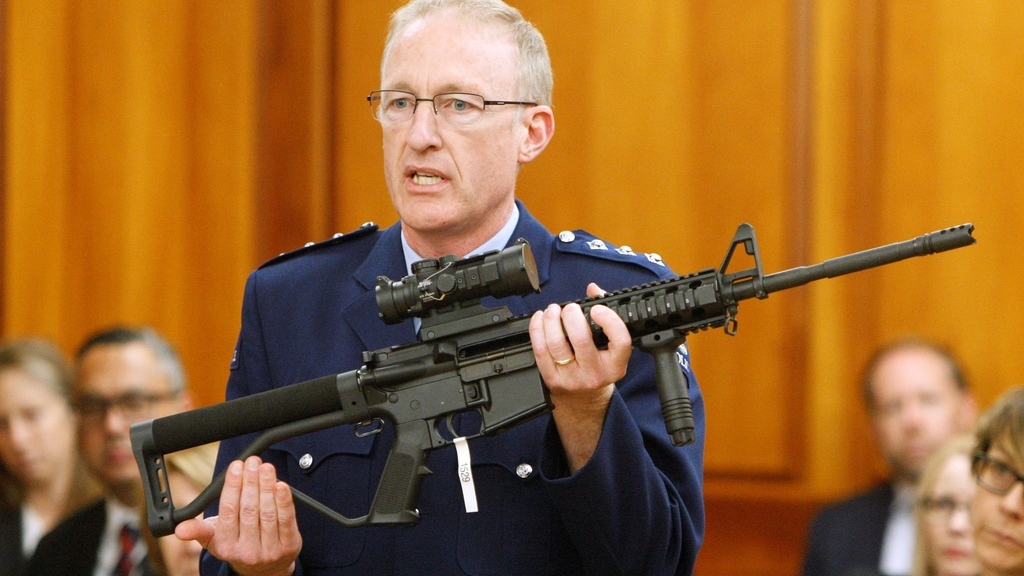 In this April 2, 2019, file photo, police acting superintendent Mike McIlraith shows New Zealand lawmakers an AR-15 style rifle similar to one of the weapons a gunman used to slaughter 51 worshippers at two Christchurch mosques, in Wellington, New Zealand. (AP Photo/Nick Perry, File)