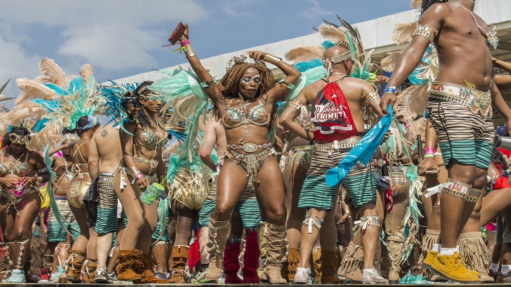 People wearing costumes dancing at the sambadrome during the Carnival celebration in Port of Spain, Trinidad and Tobago. (Photo: iStock)