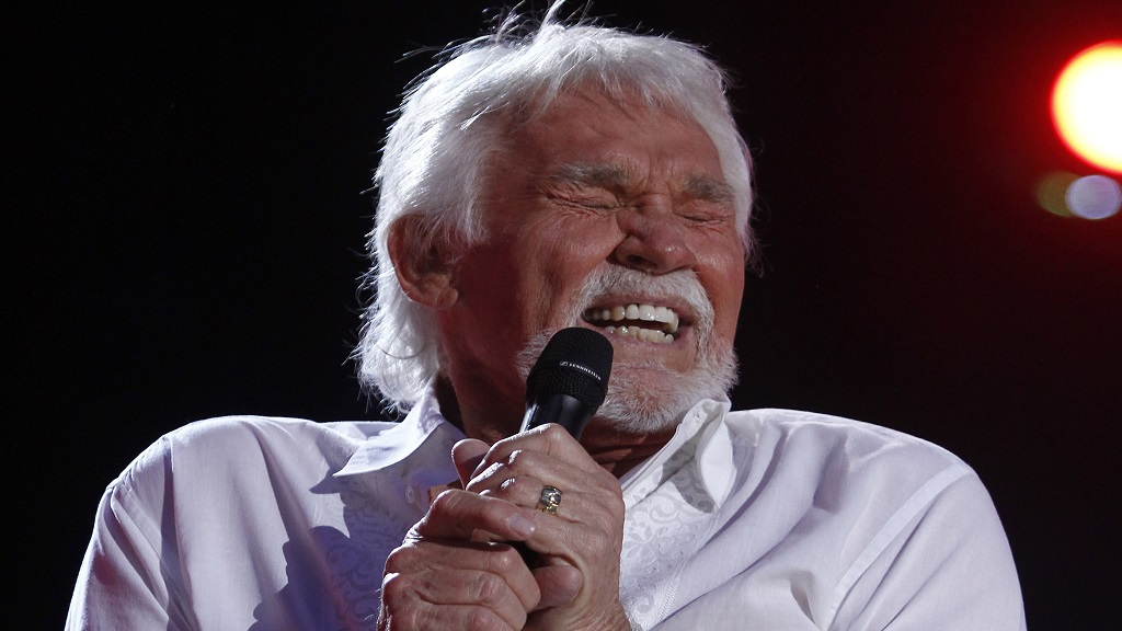 In this June 9, 2012, file photo, Kenny Rogers performs at the 2012 CMA Music Festival in Nashville. (Photo by Wade Payne/Invision/AP, File)
