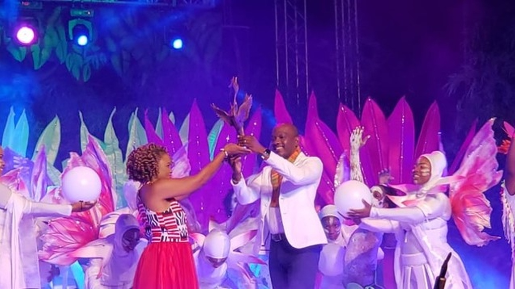 Antigua and Barbuda Culture Minister Daryll Matthew accepts the Carifesta baton from T&T Culture Minister Dr Nyan Gadsby-Dolly.