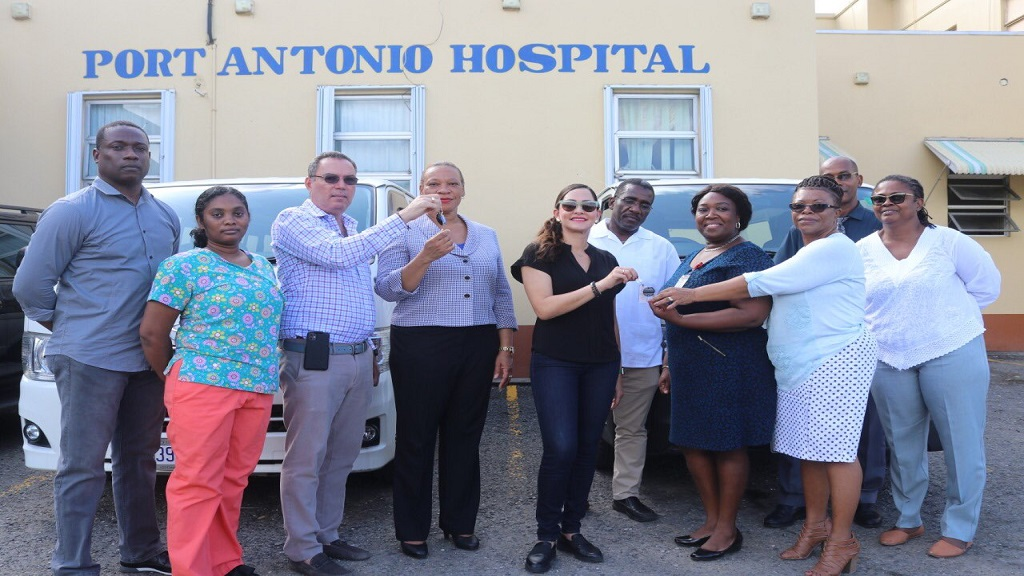 Members of Parliament (MPS) in Portland, Daryl and Ann-Marie Vaz (third and fifth left, respectively), along with Portland health sector interests, participate in a handing-over ceremony of three buses to transport health sector workers in the parish during the ongoing coronavirus crisis locally, on Friday at the Port Antonio Hospital.