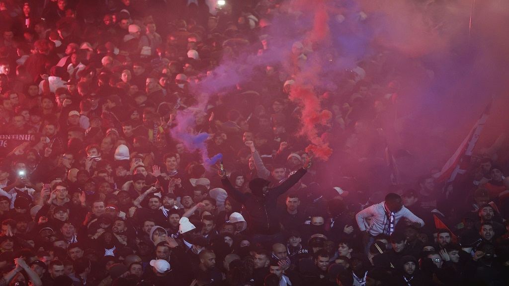 Paris Saint Germain's fans celebrate victory over Borussia Dortmund after their Champions League round of 16 second leg football match on Wednesday, March 11, 2020 in Paris. The match was played in an empty stadium because of the coronavirus outbreak. (UEFA via AP).