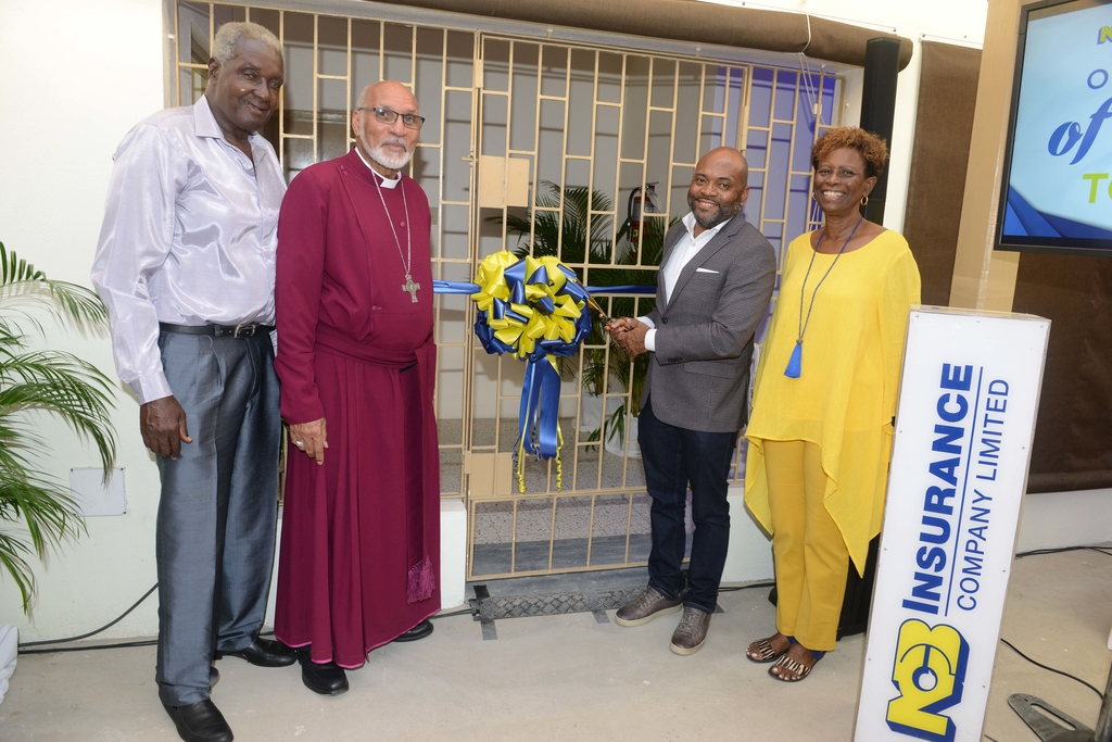 L-R: Rex Hartford James, Pensioner's Trustee; Reverend  Howard Gregory, Archbishop of the West Indies, Primate & Metropolitan & Bishop of Jamaica and the Cayman Islands; Vernon James, CEO NCB Insurance Company; Audre Spence, NCB Pensioners Association & Centre Manager.