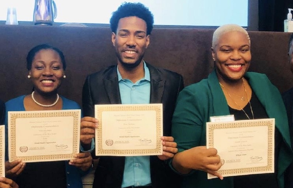 From L-R: Ms Joneille Johnson, Dr Ryan Abraham and Ms Terriann Baker, delegates from The UWI St. Augustine Campus Institute of International Relations celebrate after winning commendations in the 2020 Harvard National Model United Nations
