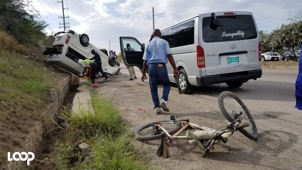 A police officer processing the scene of the fatal accident involving a bicycle and a Toyota Hiace bus.