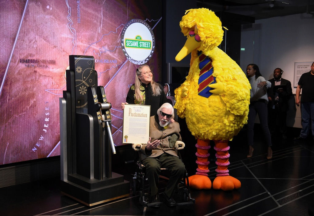 n this Friday, Nov. 8, 2019, file photo, Sesame Street's Big Bird and puppeteer Caroll Spinney participate in the ceremonial lighting of the Empire State Building in honor of Sesame Street's 50th anniversary in New York.