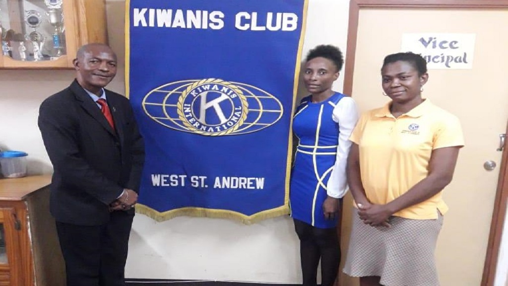 From left: Paul Messam, Red Hills Primary School's principal,  Marie Brown, Kiwanis Club of West St. Andrew's president, and Marshalyn Rose, project initiator and coordinator, take a photo following the assessment activity.