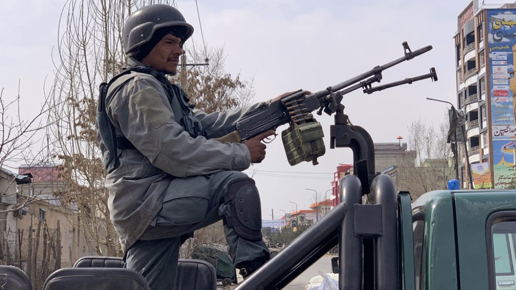 Afghan security personnel arrive at the site of an attack in Kabul, Afghanistan, Friday, March 6, 2020. Gunmen in Afghanistan's capital of Kabul attacked a remembrance ceremony for a minority Shiite leader on Friday, wounding more than a dozen of people, officials said. (AP Photo/Rahmat Gul)