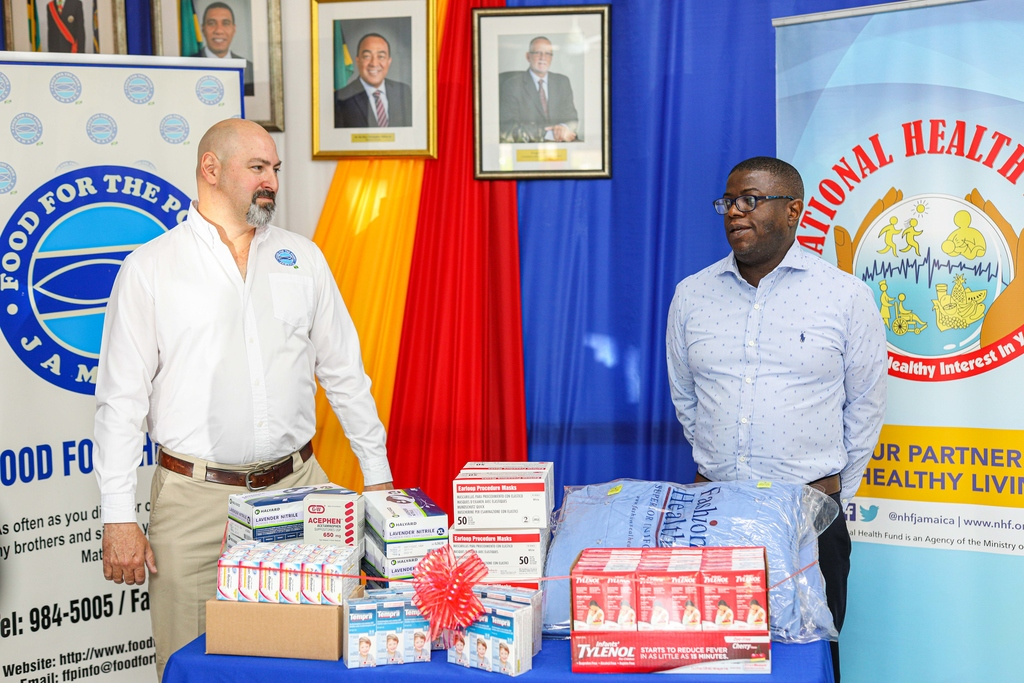 CEO for the National Health Fund, Everton Anderson (right), expresses gratitude to Director of Food for the Poor, Craig Moss-Solomon, for the medical supplies received in response to COVID-19.
