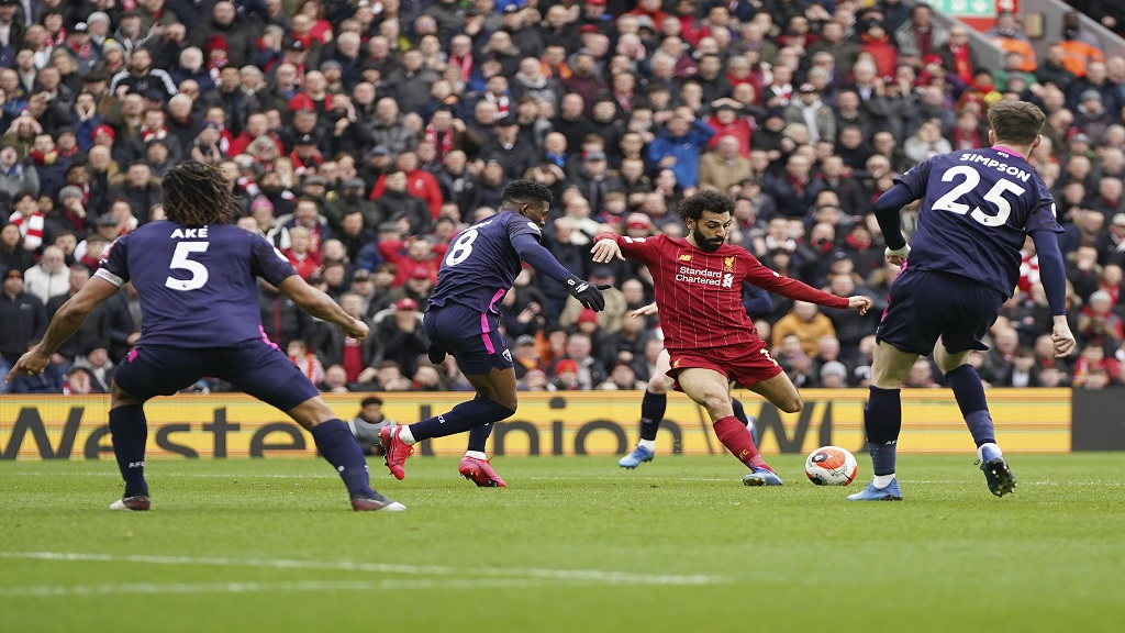 Liverpool's Mohamed Salah, second from right, scores his side's opening goal during the English Premier League football match against Bournemouth at Anfield stadium in Liverpool, England, Saturday, March 7, 2020. (AP Photo/Jon Super).