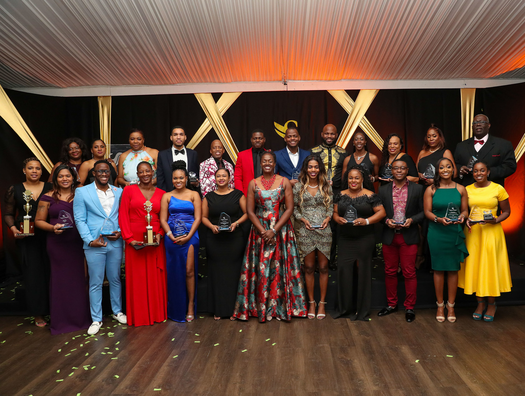 Flanked by the night's winners, a proud Chorvelle Johnson- Cunningham, Sagicor Bank CEO, is all smiles at the annual Sagicor Bank Awards ceremony on Saturday (February 29) at the Spanish Court Hotel – The Worthington