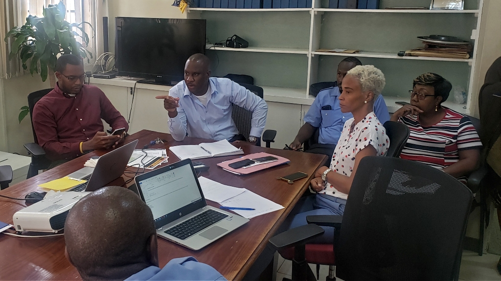 Chief Executive Officer of the Transport Board Fabian Wharton (second from right) updating representatives of various department