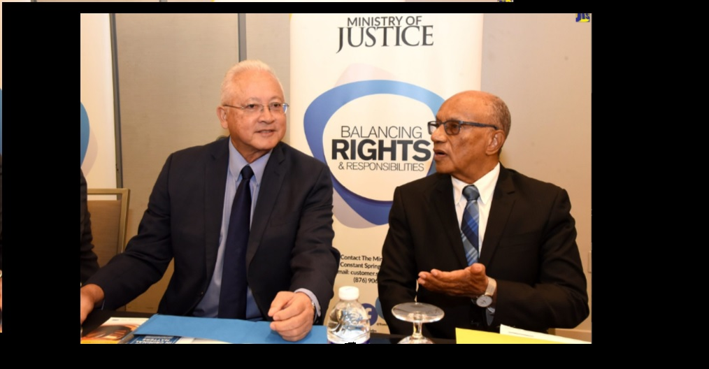 Justice Minister, Delroy Chuck (left); and Executive Director of National Integrity Action (NIA), Professor Trevor Munroe, are in discussion at a Legal Aid Council (LAC) sensitisation session held recently in Kingston