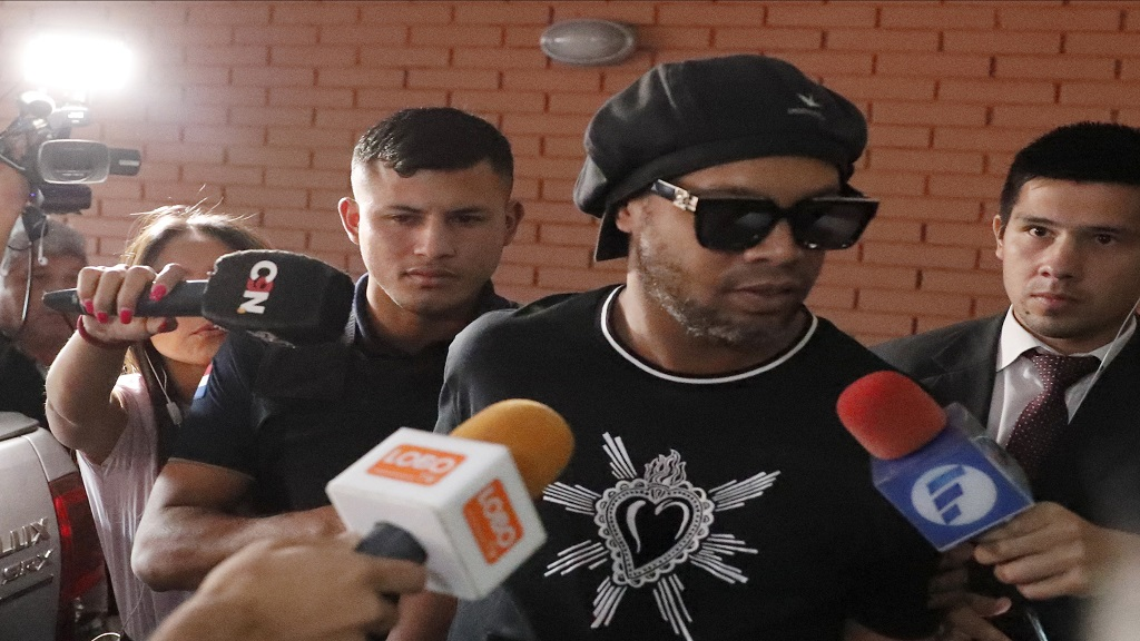 Former Brazilian football star Ronaldinho enters Paraguay's attorney offices in Asuncion, Paraguay, Thursday, March 5, 2020. According to local news, Ronaldinho is accused of arriving in the country with a fake Paraguay passport. (AP Photo/Jorge Saenz).