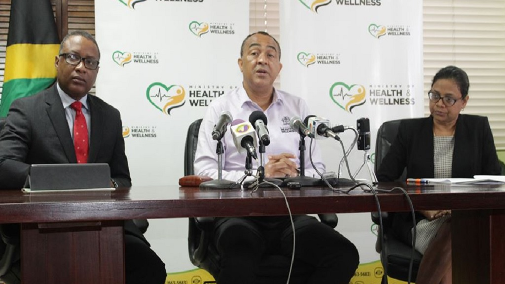 Minister of Health and Wellness, Dr Christopher Tufton (centre), addresses journalists at a press conference Thursday. With the Minister are (from left) Permanent Secretary, Dunston Bryan and Chief Medical Officer, Dr Jacquiline Bisasor-McKenzie.