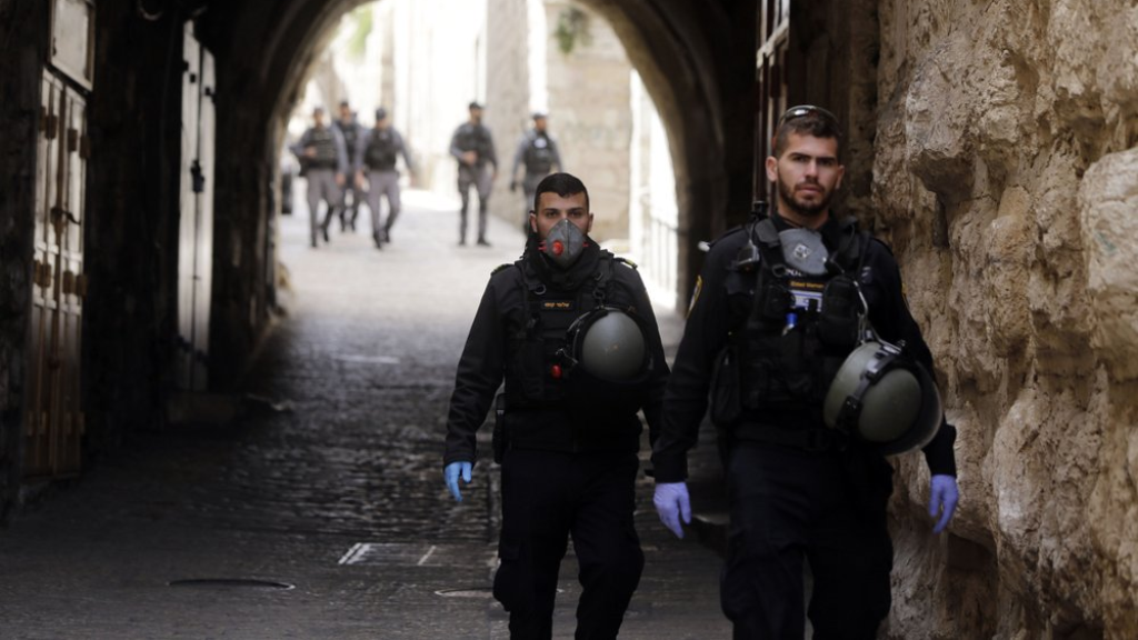 Israeli police patrols deserted street in Jerusalem's Old City, in Jerusalem, Monday, March 23, 2020. In Israel daily life has largely shut down with coronavirus cases multiplying greatly over the past week, (AP Photo/Mahmoud Illean)